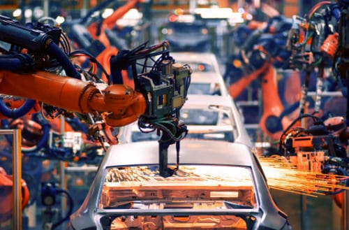 Production line for motor vehicles with automated robotic arms